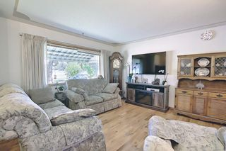 Photo 5: 306 Ashley Crescent SE in Calgary: Acadia Detached for sale : MLS®# A1120669
