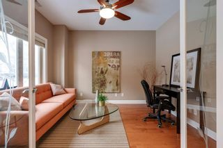 Photo 6: 34 Cougar Ridge Landing SW in Calgary: Cougar Ridge Row/Townhouse for sale : MLS®# A1075174