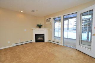 Photo 3: 113 6868 SIERRA MORENA Boulevard SW in Calgary: Signal Hill Condo for sale : MLS®# C4143308