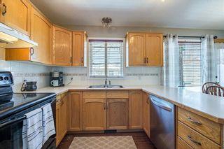 Photo 8: 59 CRYSTALRIDGE Close: Okotoks House for sale : MLS®# C4177161