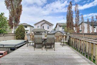 Photo 5: 140 Douglas Ridge Green SE in Calgary: Douglasdale/Glen Detached for sale : MLS®# A1114470