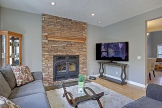 Photo 7: 145 TREMBLANT Place SW in Calgary: Springbank Hill Detached for sale : MLS®# A1024099