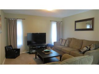 Photo 12: 179 Sunset Close: Cochrane Residential Detached Single Family for sale : MLS®# C3596629