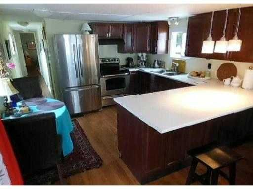 """Main Photo: 23 4200 DEWDNEY TRUNK Road in Coquitlam: Ranch Park Manufactured Home for sale in """"HIDEWAY PARK"""" : MLS®# V984553"""