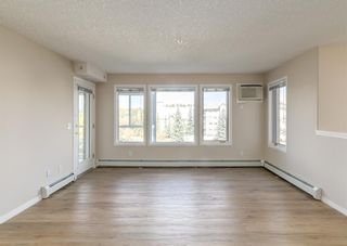 Photo 2: 326 7229 Sierra Morena Boulevard SW in Calgary: Signal Hill Apartment for sale : MLS®# A1147916