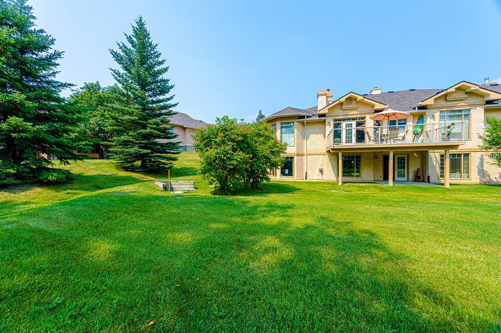 Main Photo: 126 Country Club Lane in Rural Rocky View County: Rural Rocky View MD Semi Detached for sale : MLS®# A1129942