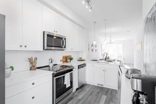 Photo 1: 25 Evanscrest Park NW in Calgary: Evanston Row/Townhouse for sale : MLS®# A1067562