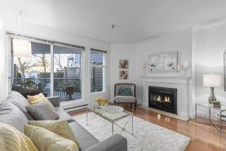 "Photo 1: 108 2020 W 8TH Avenue in Vancouver: Kitsilano Condo for sale in ""AUGUSTINE GARDENS"" (Vancouver West)  : MLS®# R2323601"