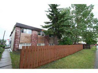 Photo 2: 7712 HUNTERVIEW Drive NW in CALGARY: Huntington Hills 4Plex for sale (Calgary)  : MLS®# C3630605