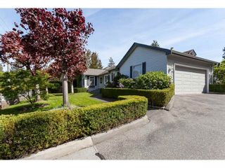 Photo 1: 101 1744 128 STREET in Surrey: Crescent Bch Ocean Pk. Townhouse for sale (South Surrey White Rock)  : MLS®# R2367189
