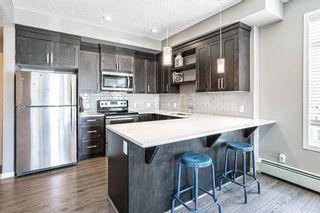 Photo 3: 112 6603 New Brighton Avenue SE in Calgary: New Brighton Apartment for sale : MLS®# A1122617