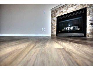 Photo 4: 201 16 POPLAR Avenue: Okotoks Condo for sale : MLS®# C3651941