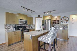 Photo 10: 140 Douglas Ridge Green SE in Calgary: Douglasdale/Glen Detached for sale : MLS®# A1114470