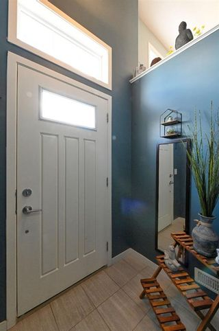 Photo 4: 628 Copperpond Boulevard SE in Calgary: Copperfield Row/Townhouse for sale : MLS®# A1104254