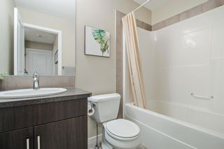 Photo 16: 1204 10 AUBURN BAY Avenue SE in Calgary: Auburn Bay Row/Townhouse for sale : MLS®# A1065411