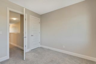 Photo 27: 52 Windford Drive SW: Airdrie Row/Townhouse for sale : MLS®# A1120634
