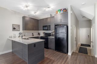 Photo 9: 205 Jumping Pound Common: Cochrane Row/Townhouse for sale : MLS®# A1138561