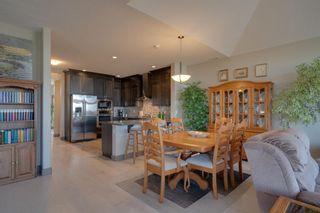 Photo 12: 40 Cougar Ridge Landing SW in Calgary: Cougar Ridge Row/Townhouse for sale : MLS®# A1148928