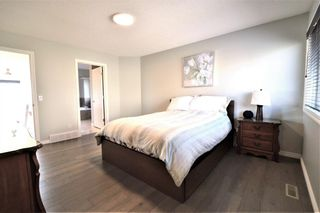 Photo 19: 7476 Springbank Way SW in Calgary: Springbank Hill Detached for sale : MLS®# A1071854