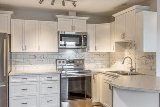 Photo 5: 311 10 Sierra Morena Mews SW in Calgary: Signal Hill Apartment for sale : MLS®# A1093086
