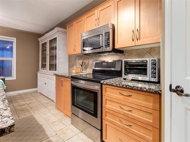 Photo 8: Photos: 40 COUGARSTONE Manor SW in Calgary: Cougar Ridge House for sale : MLS®# C4087798