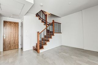 Photo 16: 14609 SHAWNEE Gate SW in Calgary: Shawnee Slopes Row/Townhouse for sale : MLS®# A1010386