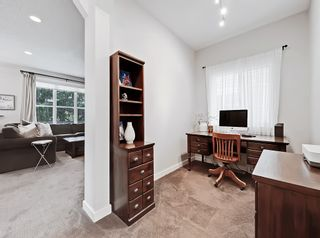Photo 10: 110 Ypres Green SW in Calgary: Garrison Woods Detached for sale : MLS®# A1116554