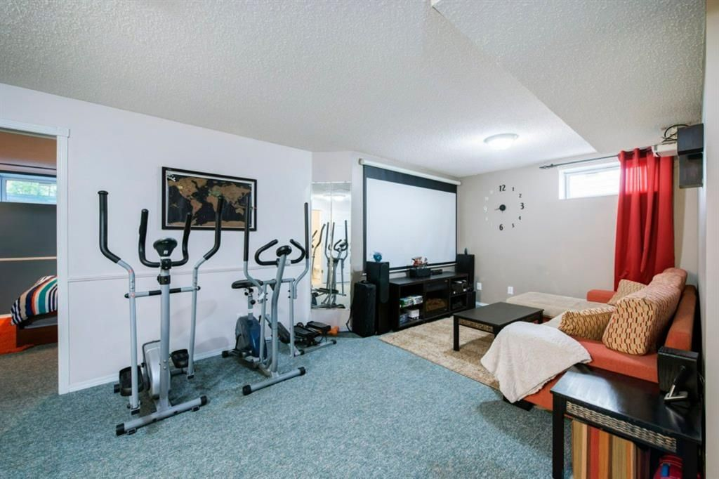 Photo 34: Photos: 10 MT BREWSTER Circle SE in Calgary: McKenzie Lake Detached for sale : MLS®# A1025122