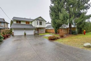 Photo 1: 638 ROBINSON Street in Coquitlam: Coquitlam West House for sale : MLS®# R2230447
