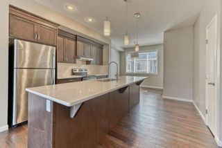 Photo 5: 539 Panatella Walk NW in Calgary: Panorama Hills Row/Townhouse for sale : MLS®# A1125854