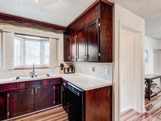 Photo 5: 296 Queen Alexandra Road SE in Calgary: Queensland Detached for sale : MLS®# A1088283