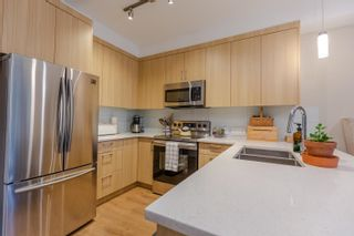 """Photo 5: 106 12460 191 Street in Pitt Meadows: Mid Meadows Condo for sale in """"ORION"""" : MLS®# R2617852"""