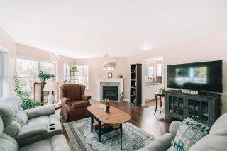 "Photo 1: 306 12633 72 Avenue in Surrey: West Newton Condo for sale in ""College Park"" : MLS®# R2561377"