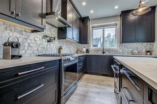 Photo 6: 715 71 Avenue SW in Calgary: Kingsland Detached for sale : MLS®# A1134081