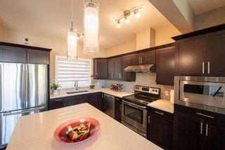 Photo 4: 115 Kincora Heath NW in Calgary: Kincora Row/Townhouse for sale : MLS®# A1124049