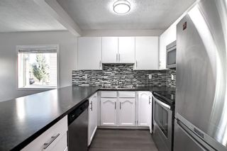 Photo 6: 29 Country Hills Rise NW in Calgary: Country Hills Row/Townhouse for sale : MLS®# A1149774