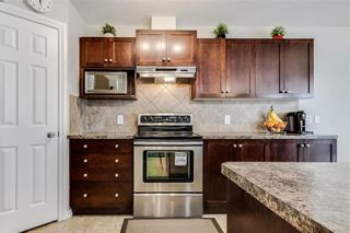 Photo 4: 81 ROYAL CREST View NW in Calgary: Royal Oak Semi Detached for sale : MLS®# C4253353