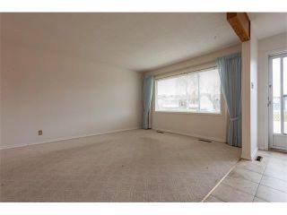 Photo 2: 1203 MACKID Road NE in Calgary: Mayland Heights House for sale : MLS®# C4036738