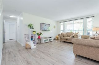 """Photo 1: 209 223 MOUNTAIN Highway in North Vancouver: Lynnmour Condo for sale in """"Mountain Village"""" : MLS®# R2588794"""