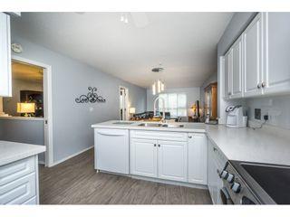 "Photo 11: 208 13860 70 Avenue in Surrey: East Newton Condo for sale in ""CHELSEA GARDENS"" : MLS®# R2160632"