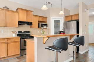 Photo 7: 138 Rockyspring Circle NW in Calgary: Rocky Ridge Detached for sale : MLS®# A1141489