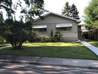 Photo 1: 1028 / 1026 39 Avenue NW in Calgary: Cambrian Heights Duplex for sale : MLS®# A1050074