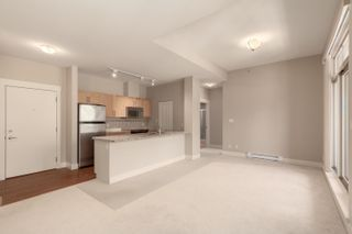 """Photo 5: 603 1211 VILLAGE GREEN Way in Squamish: Downtown SQ Condo for sale in """"ROCKCLIFF"""" : MLS®# R2573545"""