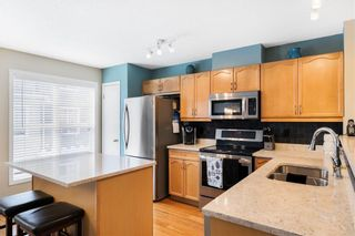Photo 10: 206 TOSCANA Gardens NW in Calgary: Tuscany Row/Townhouse for sale : MLS®# A1088865