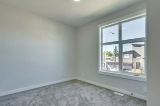 Photo 29: 1104 40 Street SW in Calgary: Rosscarrock Row/Townhouse for sale : MLS®# A1034743