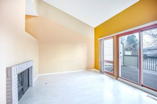 Photo 6: 7050 Edgemont Drive NW in Calgary: Edgemont Row/Townhouse for sale : MLS®# A1108400