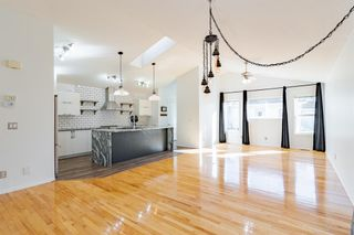 Photo 2: 48 West Springs Way SW in Calgary: West Springs Row/Townhouse for sale : MLS®# A1148807