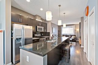 Photo 9: 628 Copperpond Boulevard SE in Calgary: Copperfield Row/Townhouse for sale : MLS®# A1104254