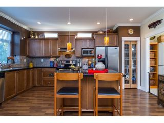 """Photo 8: 6775 206 Street in Langley: Willoughby Heights House for sale in """"TANGLEWOOD"""" : MLS®# R2140002"""