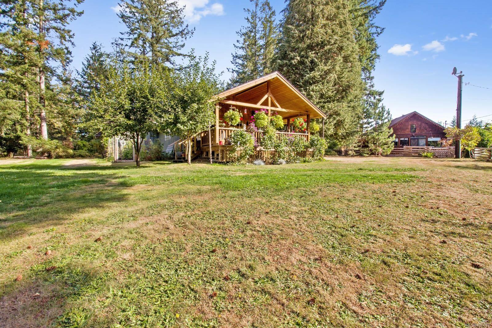 Main Photo: 2378 Ployart Rd in Black Creek: CV Merville Black Creek House for sale (Comox Valley)  : MLS®# 886657